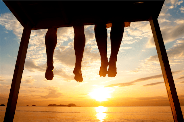 legs pier sunset feet toes silhouette dangling summer orange yellow black locations