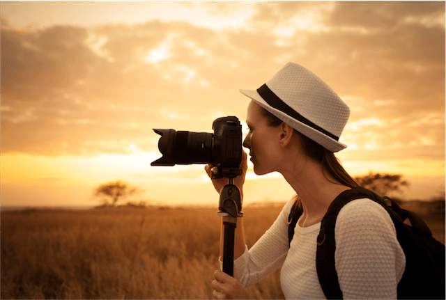 lady camera hat wild sunset tripod photographer locations