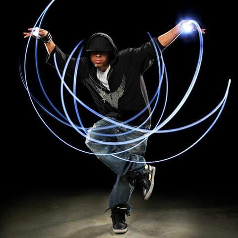 man dance light trails hoodie hat black grey blue