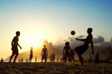 kids children football sunset action sports silhouette dusk sky clouds blue golden hour