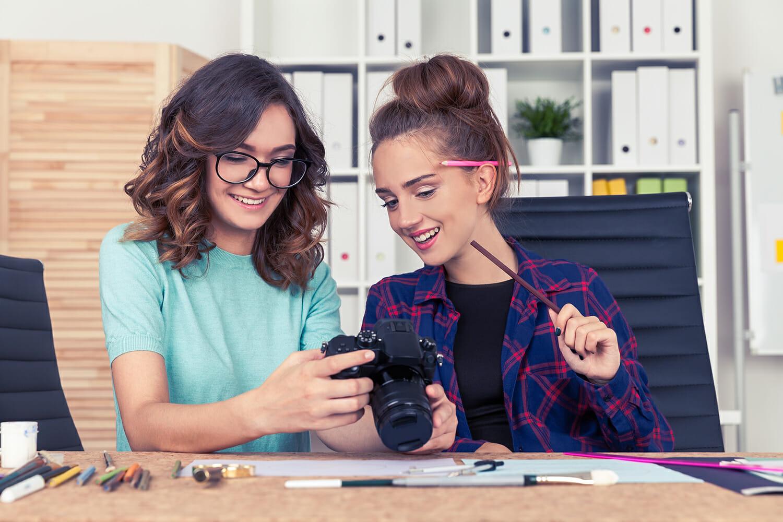 female ladies camera desk work photographers creative block