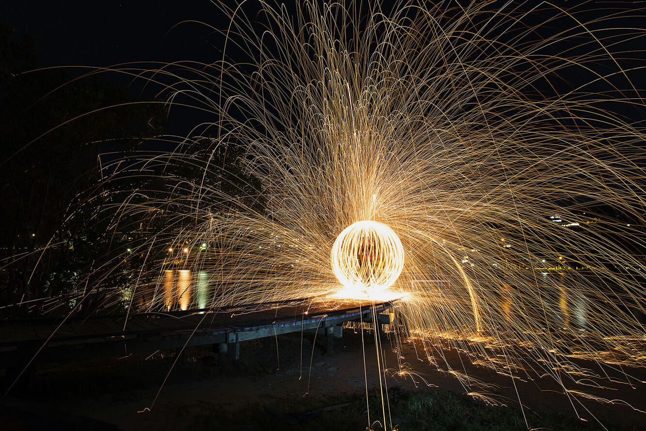 wire wool fire spinning long exposure light trick photography