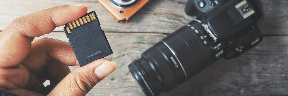 hand holding memory card camera photography