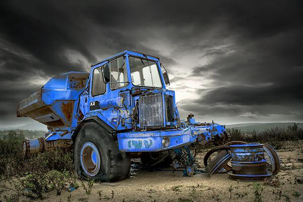 tractor blue field moody sky