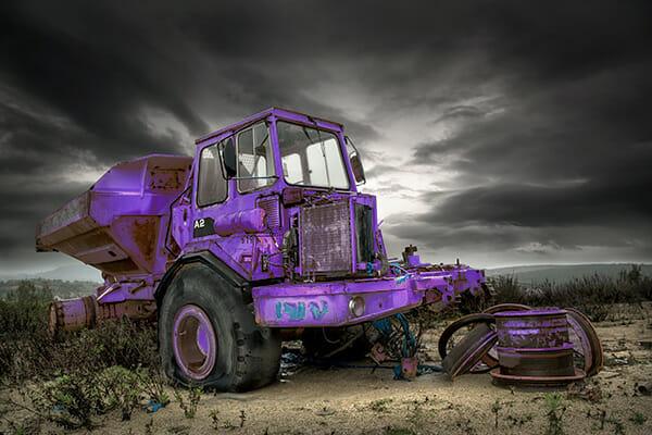 tractor purple field moody sky