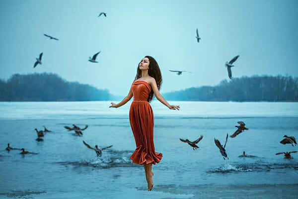 model levitation photography floating water orange dress blue water birds